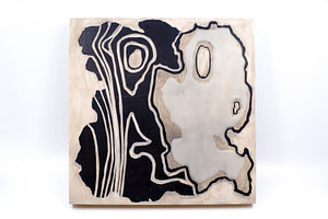 Image description: The unveiled artwork is an organic, abstract shape made of raised acrylic paint and wax on a wood panel.
